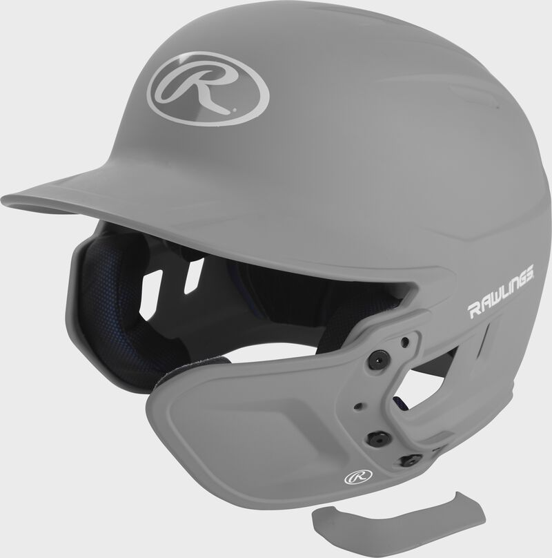 A matte silver MEXT attached to a Mach batting helmet showing the hardware