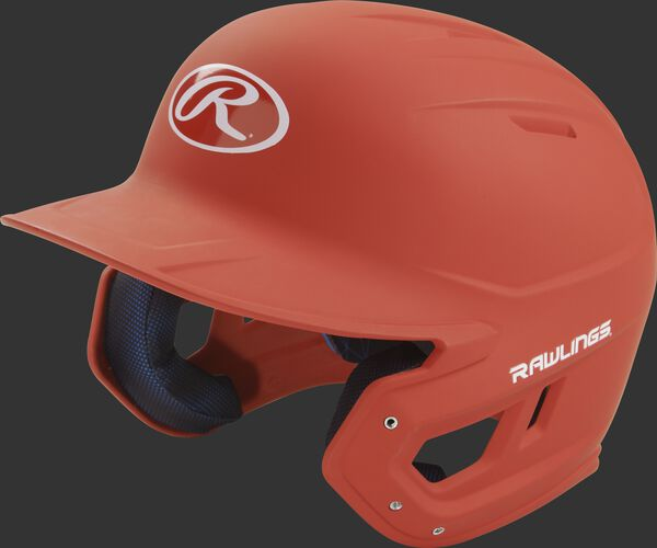 Left angle view of a Rawlings MACH helmet with a one-tone matte burnt orange shell