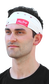 A guy wearing a white baseball stitch multi-functional neck gaiter as a head band - SKU: RC40001-100 image number null