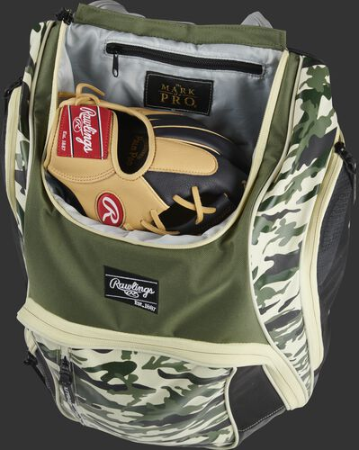 A glove in the dedicated glove storage pocket of a Rawlings Legion equipment backpack - SKU: LEGION-CAMO