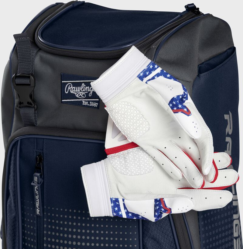 Two batting gloves hanging on the front Velcro strap of a Franchise baseball backpack - SKU: FRANBP-N