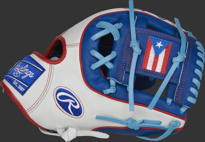 Thumb of a white/royal PRO314-2PR Heart of the Hide Puerto Rico infield glove with a PR flag on the royal I-web
