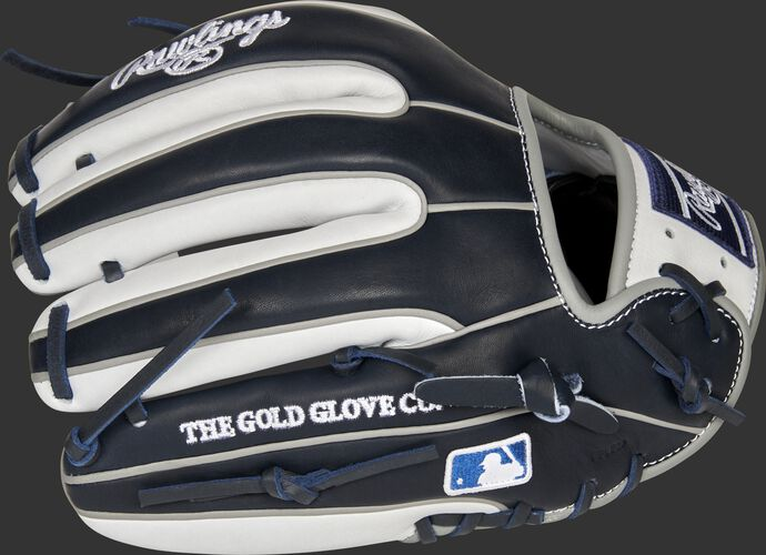 Navy/white back of a New York Yankees Heart of the Hide infield glove with the MLB logo on the pinky - SKU: RSGPRO314-2NYY