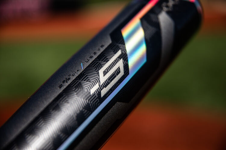 Barrel of a -5 Rawlings Velo ACP USA bat with a field in the background - SKU: USZV5
