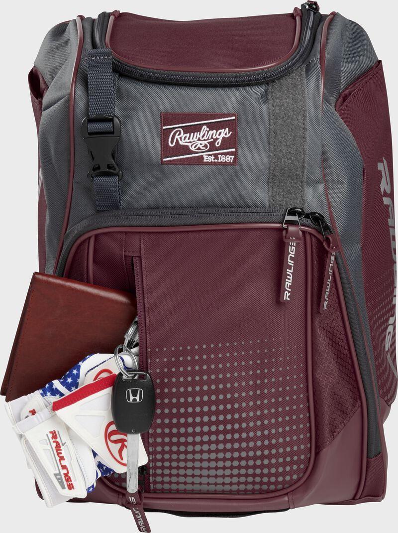 Wallet, keys, and batting gloves in the front valuables pocket of a maroon Franchise baseball bag - SKU: FRANBP-MA