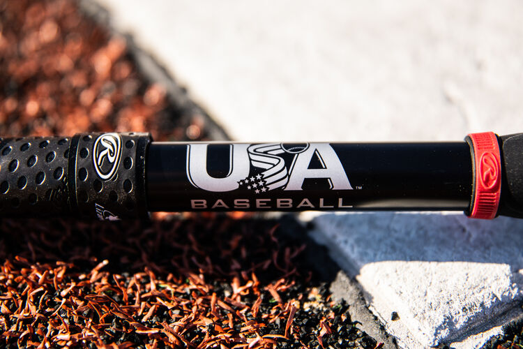 USA baseball stamp on the black handle of a Quatro Pro bat next to home plate - SKU: US1Q8