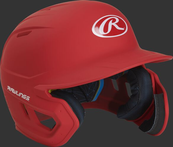 Right angle view of a MACHEXTR Rawlings Mach EXT junior helmet with a one-tone matte scarlet shell